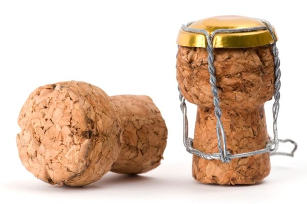 Macro picture of 2 champagne corks.